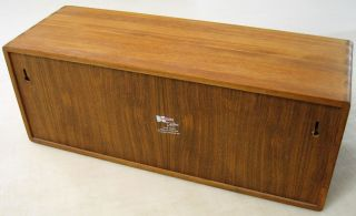 This auction is for one (1) Kalmar Designs Teak Wood 30 CD