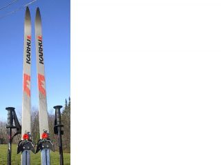 set of cross country skis with poles. The skis are signed KARHU
