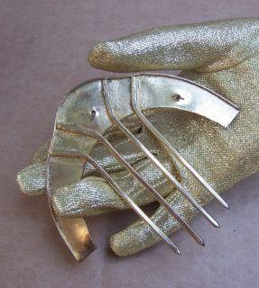 VINTAGE PALE GOLDTONE METAL HAIR COMB WITH CLEAR RHINESTONE TRIM