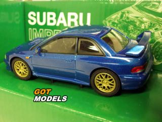 Subaru Impreza 22B 1 43 Scale Model Car in Blue with Haynes Book Gift