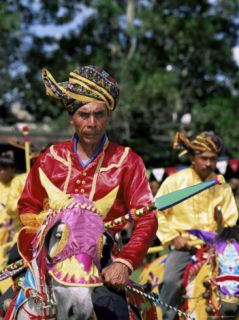 Annual Display of Horsemanship by Bajau People at Kota Belud Tamu or Market Photographic Print by Lousie Murray