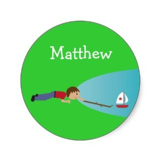 Boy playing with boat on pond stickers