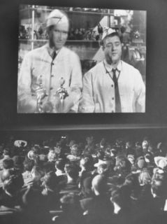 Audience at Omaha Theater Watching Abbott and Costello in Feature Picture Who Done It Premium Photographic Print by Alfred Eisenstaedt