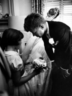 Senator John F. Kennedy Bending Down to Talk with the Flower Girl Janet Auchincloss Premium Photographic Print by Lisa Larsen