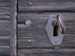 Vintage Key and Lock in Weathered Wood Planked Door Photographic Print