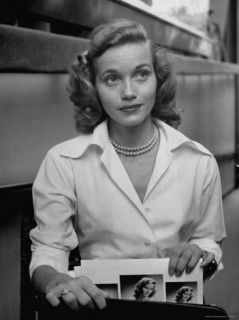 Actress Eva Maria Saint, Taking Her Portraits and Calling Cards from Her Briefcase Premium Photographic Print by Nina Leen