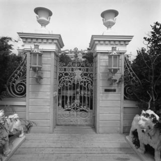 Gates and Lion Statues Photographic Print by George Marks
