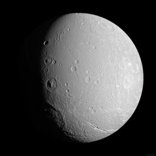 Saturns Moon Dione Photographic Print by Stocktrek Images