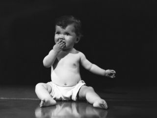Baby Girl in Nappy Sitting on Floor in Studio Photographic Print by George Marks