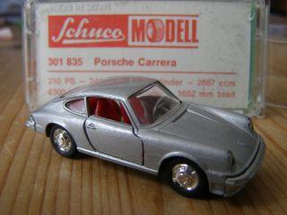 66, Porsche 911 Carrera, Nr. 835, silber met. mint in OVP