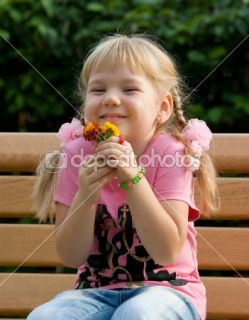 Cute little girl with flowers.  Stock Photo © Александр