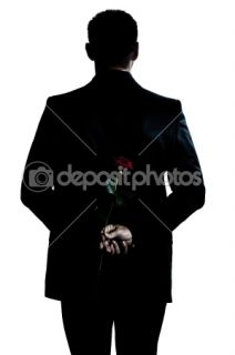 Rear view silhouette man portrait holding a rose flower  Stock Photo