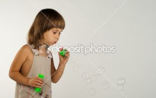 Cute little girl blowing soap bubbles  Stock Photo © Viktoria