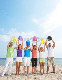 Happy people holding balloons  Stock Photo © Igor Mojzes #1856087