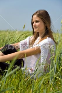 Sadness girl sitting on grass  Stock Photo © Vadim Ponomarenko