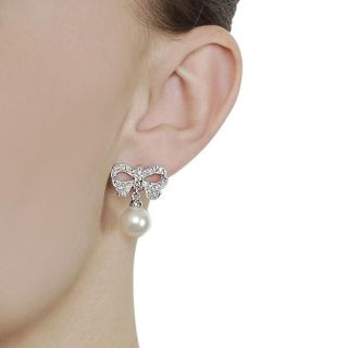 Journee Collection Silvertone Pave set CZ and Faux Pearl Bow Earrings